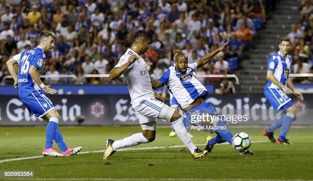 Casemiro of Real Madrid scores his team's second goal past Sidnei Da Silva of Deportivo La Coruna during the La Liga match between Deportivo La...