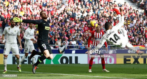 Casemiro of Real Madrid scores the opening goal during the La Liga match between Club Atletico de Madrid and Real Madrid CF at Wanda Metropolitano on...