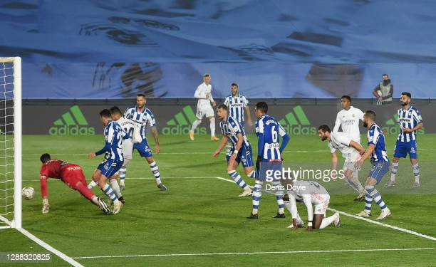Casemiro of Real Madrid scores their team's first goal during the La Liga Santander match between Real Madrid and Deportivo Alaves at Estadio...