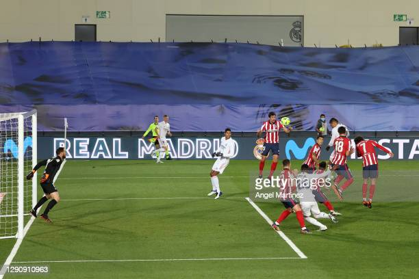 Casemiro of Real Madrid scores their team's first goal during the La Liga Santander match between Real Madrid and Atletico de Madrid at Estadio...