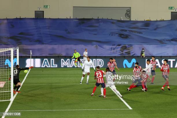 Casemiro of Real Madrid scores their team's first goal past Jan Oblak of Atletico de Madrid during the La Liga Santander match between Real Madrid...