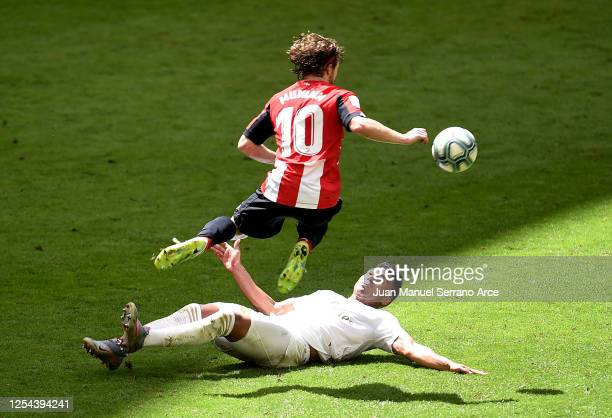 Casemiro of Real Madrid tackles Iker Muniain of Athletic Club during the La Liga match between Athletic Club and Real Madrid CF at San Mames Stadium...