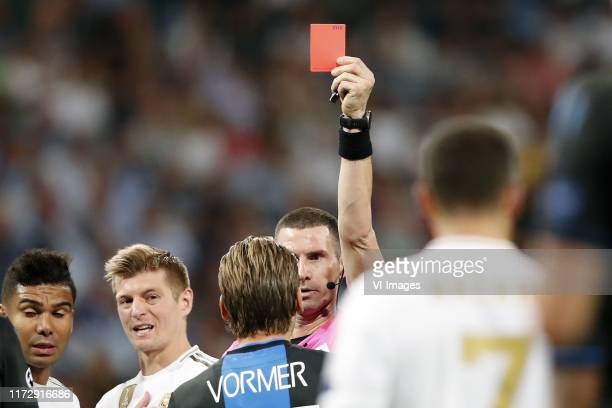 Casemiro of Real Madrid Toni Kroos of Real Madrid Ruud Vormer of Club Brugge KV referee Georgi Kabakov during the UEFA Champions League group A match...