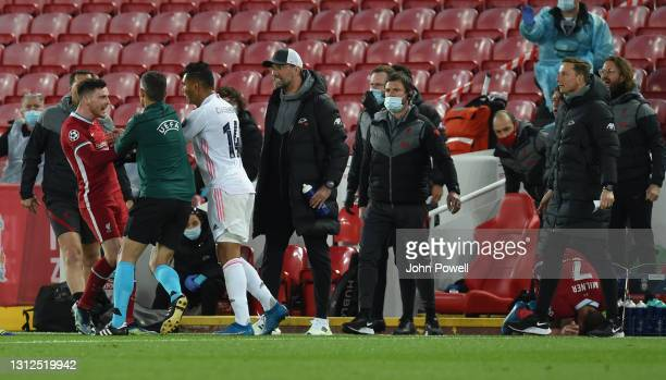 Casemiro of Real Madrid with Andy Robertson of Liverpool after a tackle on James Milner of Liverpool during the UEFA Champions League Quarter Final...