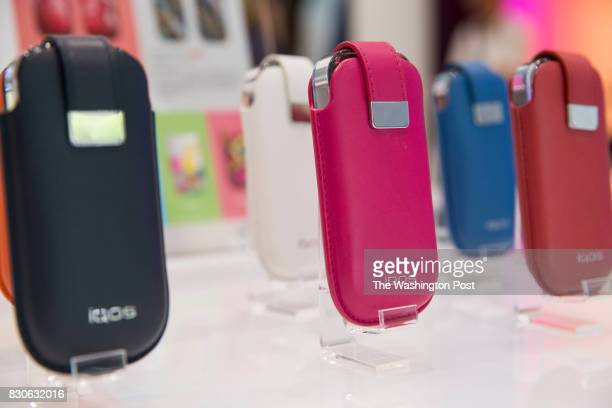 Cases for IQOS device are displayed for sale at IQOS store in Tokyo Japan on July 31 2017 Phillip Morris is trying to sell IQOS a new kind of...