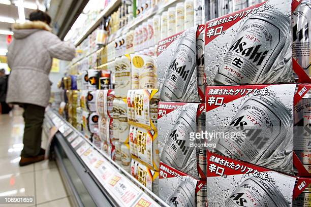 Cases of Asahi Breweries Ltd Asahi Super Dry beer are displayed for sale at a supermarket in Soka City Saitama Prefecture Japan on Tuesday Feb 8 2011...