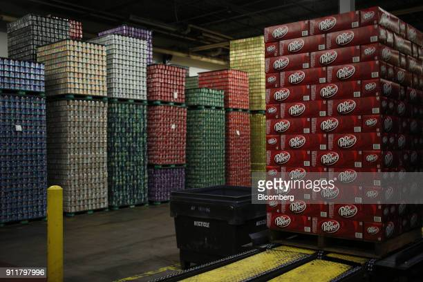 Cases of Dr Pepper brand soda sit on a wooden pallet after being filled at the Dr Pepper Snapple Group Inc bottling plant in Irving Texas US on...