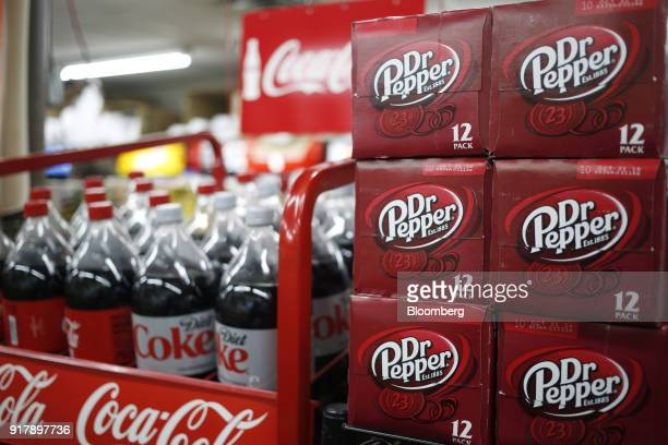 Cases of Dr Pepper brand soda sit on display for sale at a convenience store in Bagdad Kentucky US on Sunday Feb 11 2018 Dr Pepper Snapple Group Inc...
