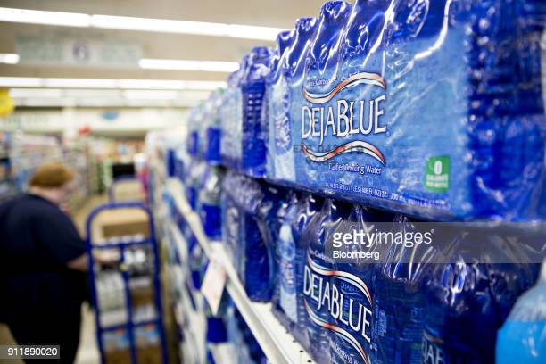 Cases of Dr Pepper Snapple Group Inc Deja Blue brand bottled water are displayed for sale at a supermarket in Princeton Illinois US on Monday Jan 29...