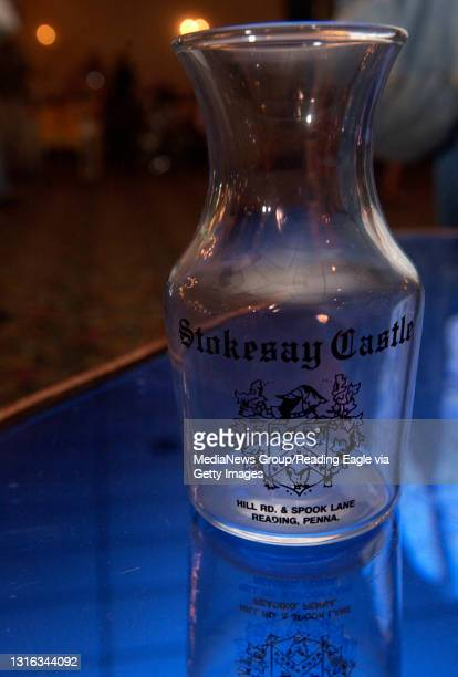 Cases of small carafes with Stokesay Castle printed on the side, as well as Hurricane glasses, and lots of other glassware were auctioned on Saturday...