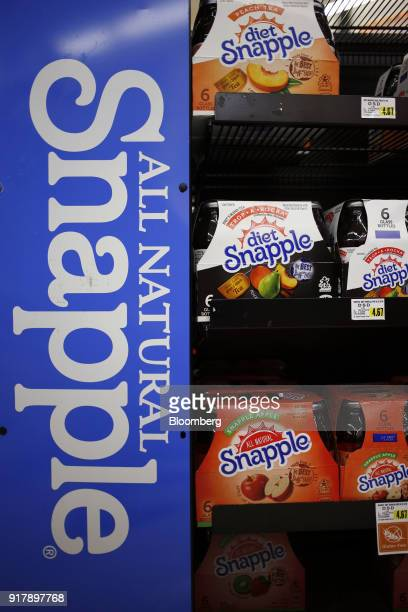 Cases of Snapple brand beverages are displayed for sale at a grocery store in Louisville Kentucky US on Tuesday Feb 13 2018 Dr Pepper Snapple Group...