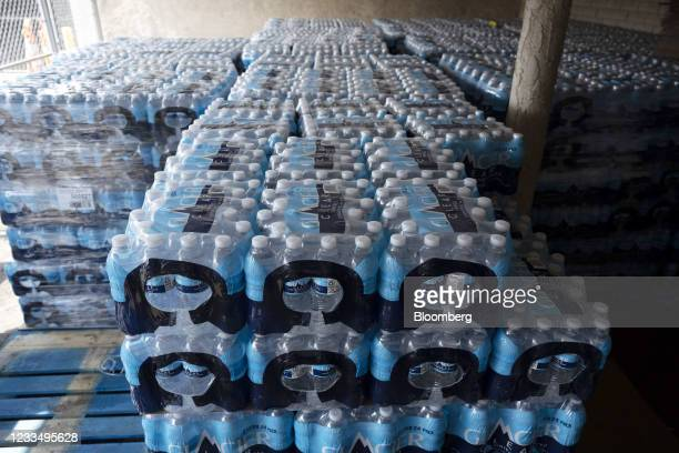 Cases of water at the Courtyard, a homeless resource center, in Las Vegas, Nevada, U.S., on Wednesday, June 16, 2021. The searing weather marks the...