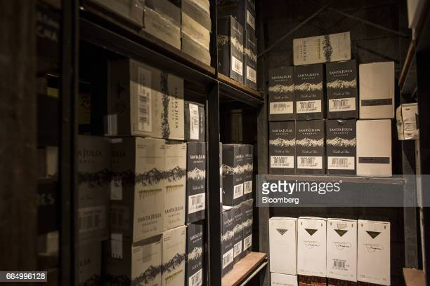 Cases of wine sit on shelves at the Bodega Santa Julia production facility in Mendoza Argentina on Tuesday March 23 2017 The Argentine wine industry...