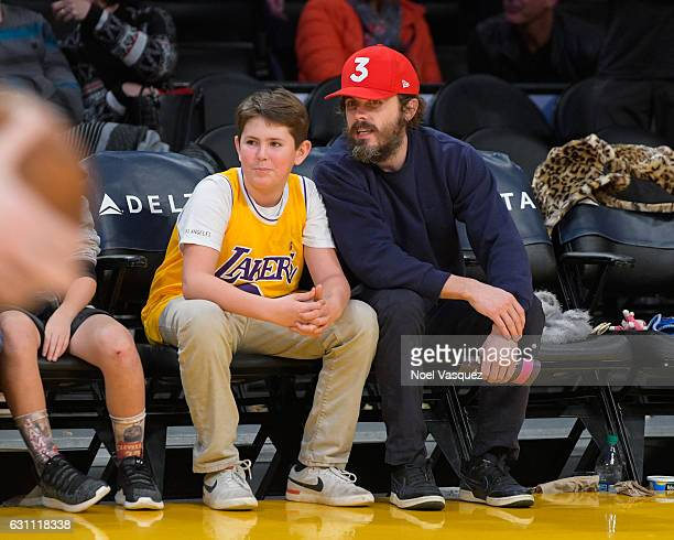Casey Affleck and son Indiana Affleck attend a basketball game between the Miami Heat and the Los Angeles Lakers at Staples Center on January 6 2017...