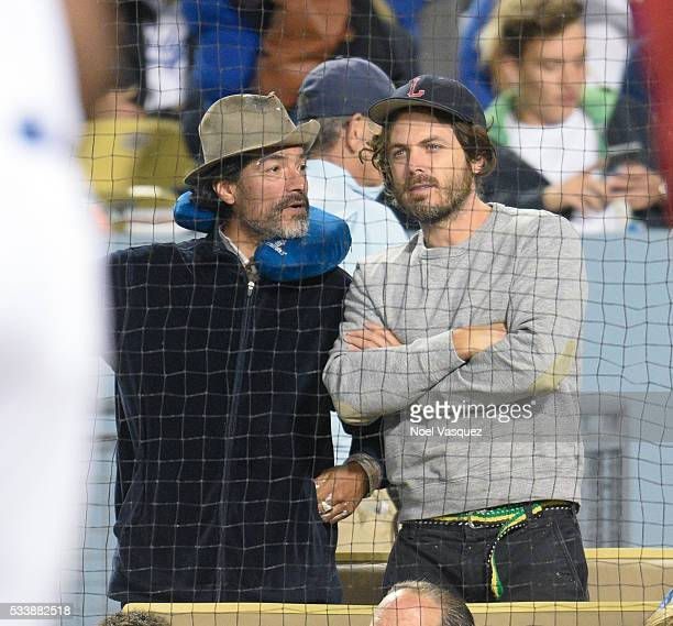 Casey Affleck attends a baseball game between the Cincinnati Reds and the Los Angeles Dodgers at Dodger Stadium on May 23 2016 in Los Angeles...