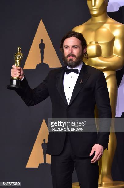 Casey Affleck poses in the press room with the Oscar for Best Actor during the 89th Annual Academy Awards on February 26 in Hollywood California /...