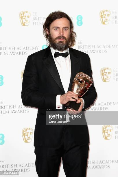 Casey Affleck with his Best Actor award for 'Manchester by the Sea' during the 70th EE British Academy Film Awards at Royal Albert Hall on February...