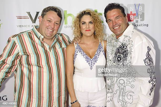 Casey and Renee Nezhoda and George Kozel arrive at The 2nd Annual The Peace Fund Celebrity Poker Tournament on September 26, 2015 in Playa Vista,...
