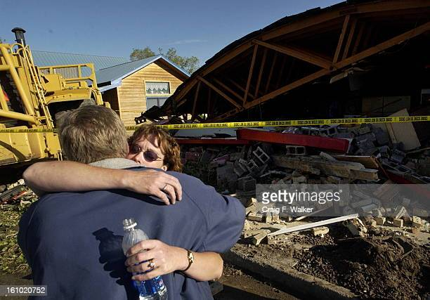 GRANBY CO JUNE 05 2004 Casey and Rhonda Farrell owners of Gambles of Grand County survey the damage to their buisness on Highway 40 in Granby CO The...