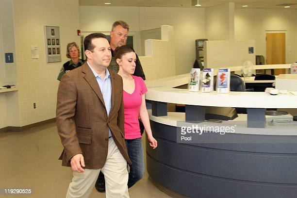 Casey Anthony leaves with her attorney Jose Baez from the Booking and Release Center at the Orange County Jail after she was acquitted of murdering...