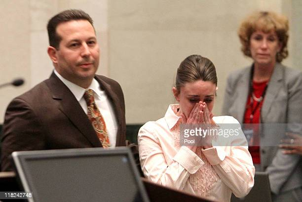 Casey Anthony reacts to being found not guilty on murder charges as she stands next to her attorney Jose Baez at the Orange County Courthouse on July...