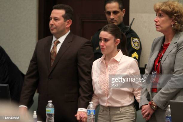 Casey Anthony reacts to being found not guilty on murder charges at the Orange County Courthouse on July 5, 2011 in Orlando, Florida. At left is her...
