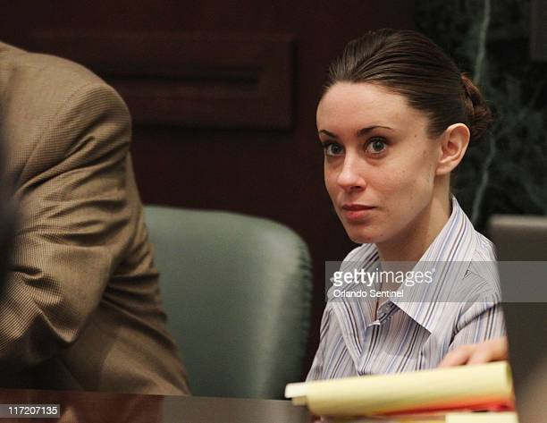 Casey Anthony sits at the defense table as her attorney Jose Baez enters before the start of her murder trial at the Orange County Courthouse in...