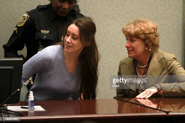 Casey Anthony sits in the courtroom and with her attorney Dorothy Clay Sims at her sentencing hearing on charges of lying to a law enforcement...