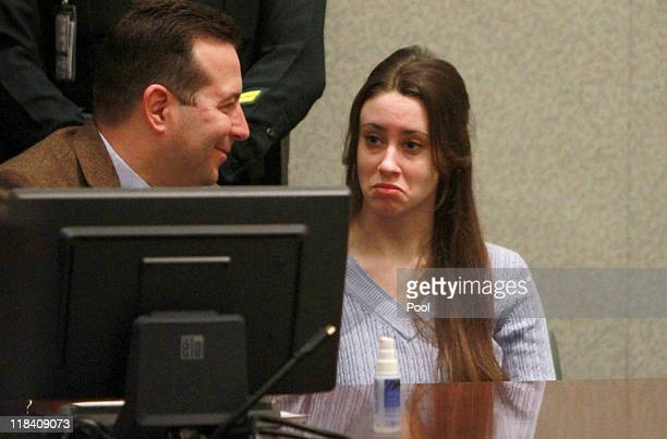 Casey Anthony sits with her attorney Jose Baez during her sentencing hearing on charges of lying to a law enforcement officer at the Orange County...