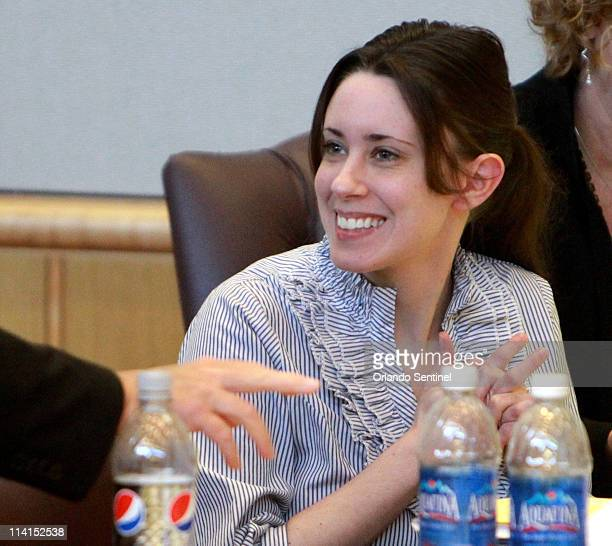 Casey Anthony smiles while talking with defense counsel in the courtroom at the Pinellas County Criminal Justice Center Friday afternoon May 13 on...