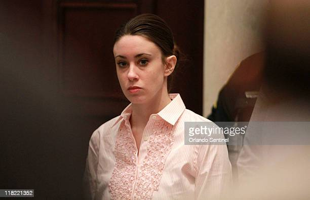 Casey Anthony stands for the arrival of the jury at the start of the second day of jury deliberations in her murder trial at the Orange County...