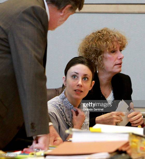 Casey Anthony talks to defense counsel Cheney Mason left with defense consultant Dorothy Clay Sims right in the courtroom at the Pinellas County...