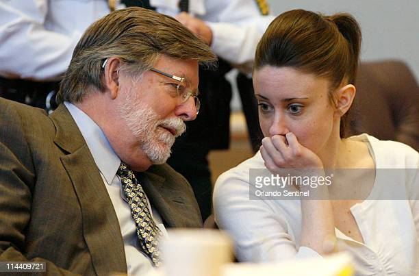 Casey Anthony talks with defense attorney Cheney Mason left during tenth day of jury selection in her trial at the Pinellas County Criminal Justice...
