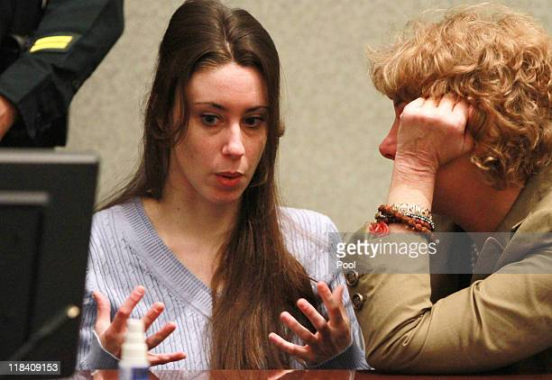 Casey Anthony talks with her attorney Dorothy Clay Sims at her sentencing hearing on charges of lying to a law enforcement officer at the Orange...