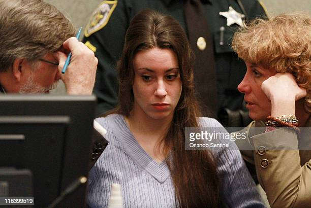 Casey Anthony talks with her attorneys before the start of her sentencing hearing at the Orange County Courthouse in Orlando, Florida, Thursday, July...