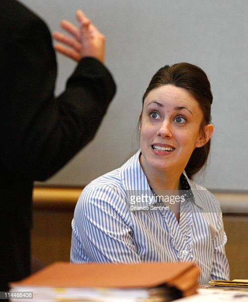 Casey Anthony talks with her defense counsel before jury selection resumes in her trial at the Pinellas County Criminal Justice Center in Clearwater...