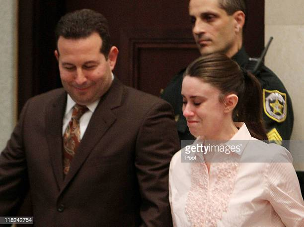 Casey Anthony with her attorney Jose Baez smiles after knowing that she has been acquitted of murder charges at the Orange County Courthouse on July...