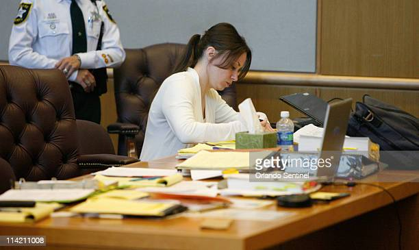 Casey Anthony writes notes during a brief recess of jury selection for her trial at the Pinellas County Criminal Justice Center Monday May 16 2011 in...