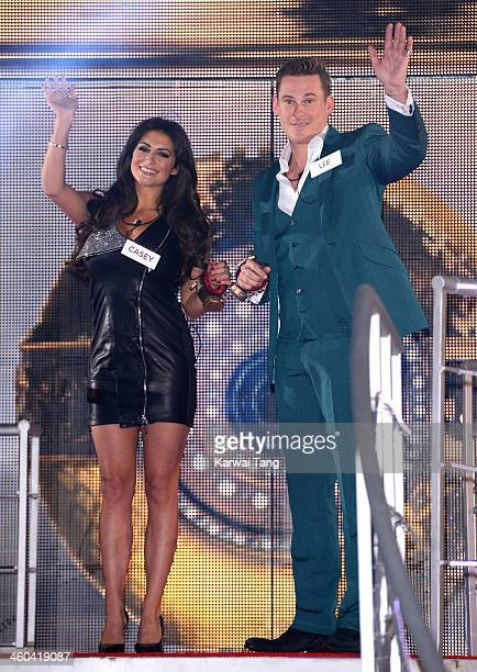 Casey Batchelor and Lee Ryan enter the Celebrity Big Brother House at Elstree Studios on January 3 2014 in Borehamwood England