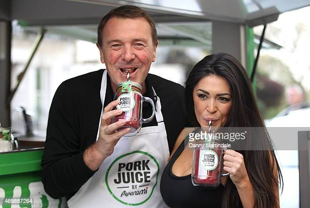 Casey Batchelor and Phil Tufnell attend a photocall to launch a new detox drink 'Pork Juice' at Regent's Park on April 16 2015 in London England