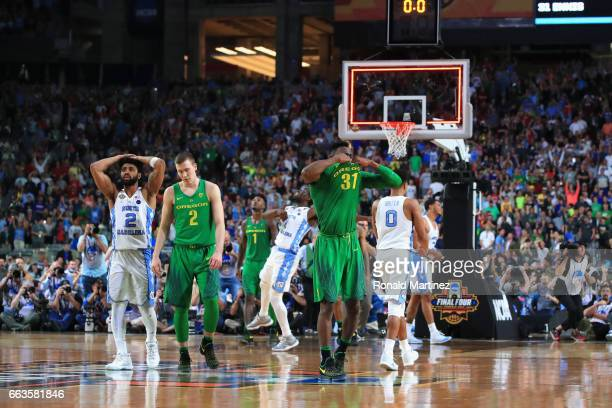 Casey Benson and Dylan Ennis of the Oregon Ducks react after being defeated by the North Carolina Tar Heels during the 2017 NCAA Men's Final Four...