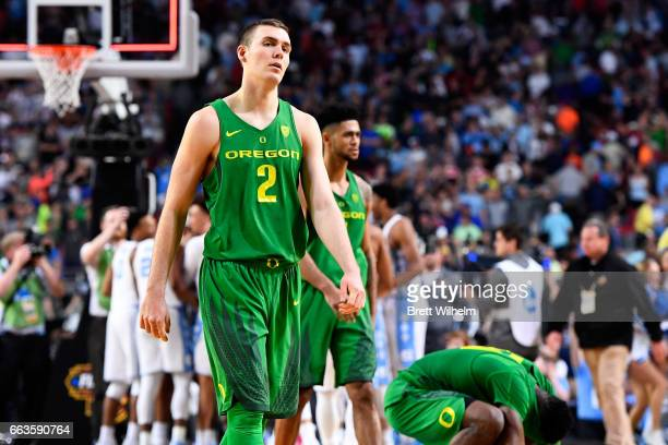 Casey Benson and Tyler Dorsey of the Oregon Ducks walk off the court after losing to the North Carolina Tar Heels during the 2017 NCAA Men's Final...