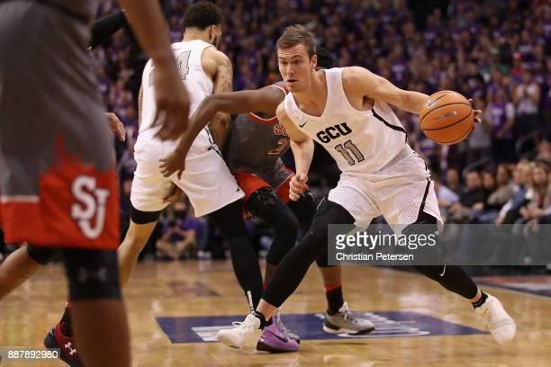 Casey Benson of the Grand Canyon Antelopes handles the ball during the first half of the college basketball game against the St John's Red Storm at...