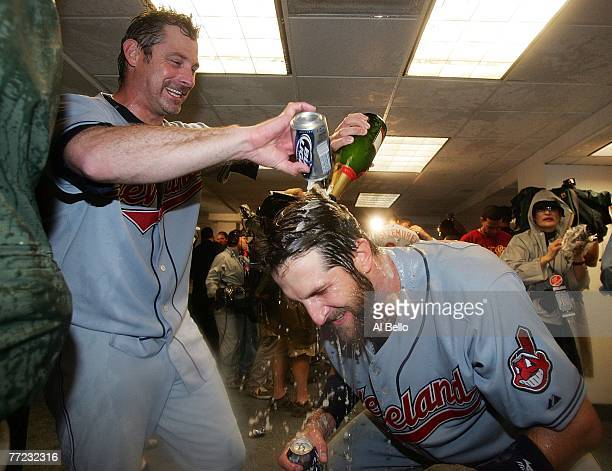 Casey Blake and Derek Shelton of the Cleveland Indians celebrate in the locker room after defeating the New York Yankees by the score of 64 to win...