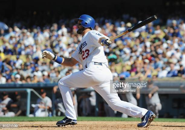 Casey Blake of the Los Angeles Dodgers hits a RBI single in the fifth inning against the San Francisco Giants at Dodger Stadium on September 19, 2009...