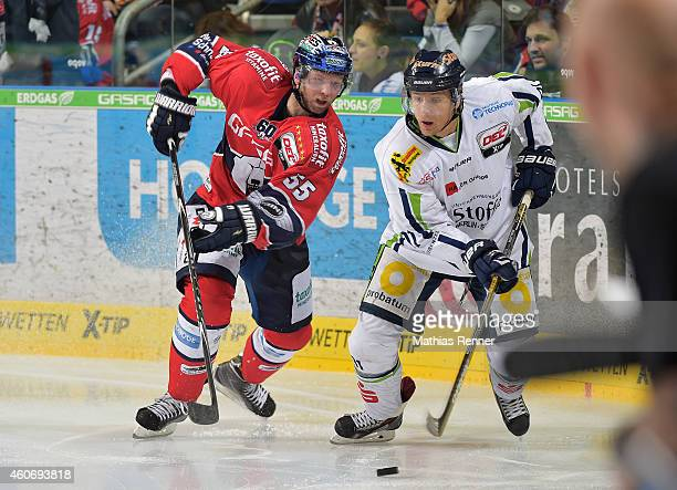 Casey Borer of the Eisbaeren Berlin and Rene Roethke of the Straubing Tigers during the game between Eisbaeren Berlin and Straubing Tigers on...
