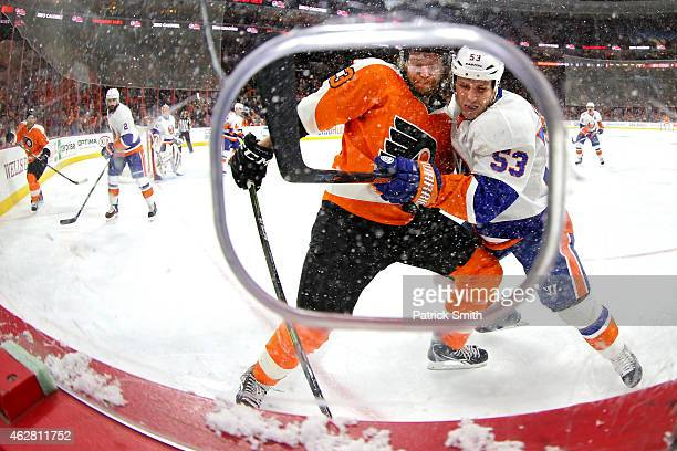 Casey Cizikas of the New York Islanders and Jakub Voracek of the Philadelphia Flyers battle for the pick in the second period at Wells Fargo Center...