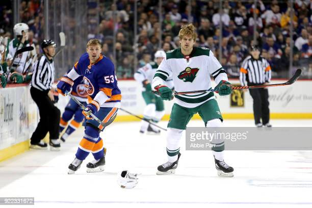 Casey Cizikas of the New York Islanders and Marcus Foligno of the Minnesota Wild lose their helmets in the first period during their game at Barclays...