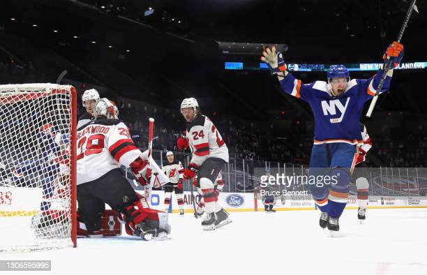 Casey Cizikas of the New York Islanders celebrates a first period goal by Matt Martin against Mackenzie Blackwood of the New Jersey Devils at the...