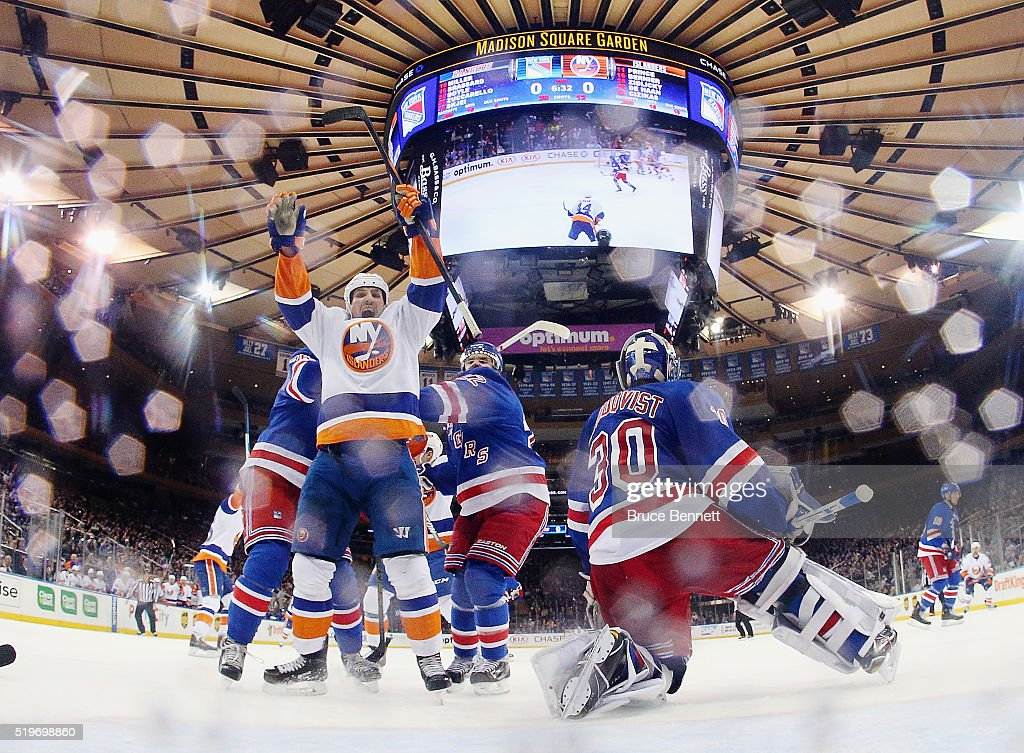 Casey Cizikas #53 of the New York Islanders celebrates a goal by Shane Prince #11 at 13:28 of the second period period against Henrik Lundqvist #30 of the New York Rangers at Madison Square Garden on April 7, 2016 in New York City. The Islanders defeated the Rangers 4-1.